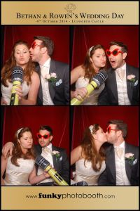The bride & groom getting funky in the photo booth