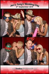 Three guests with props in the Funky Photo Booth